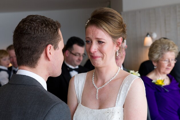 emotional brides cries tears of joy during her wedding ceremony
