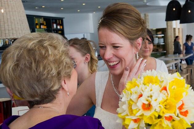 bride's mother congratulates the bride on her marriage