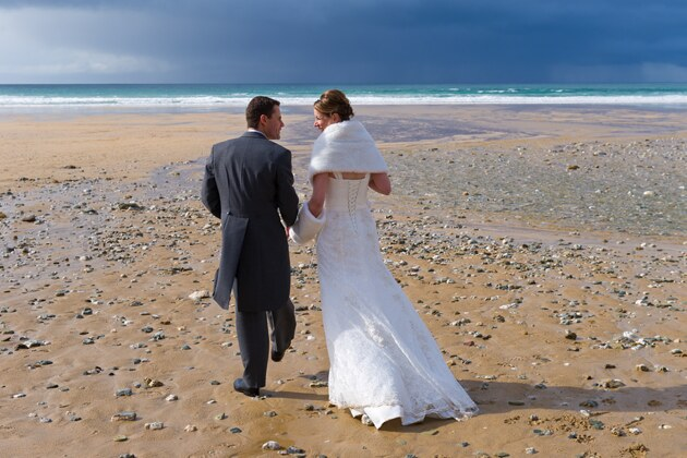 beach wedding photograph of bride and groom