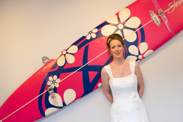 bride photographed against a surfboard
