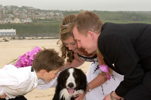Wedding day family photo on Porthmeor beach St Ives