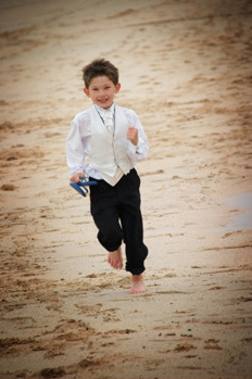 Page boy Ethan enjoys Porthmeor beach St Ives
