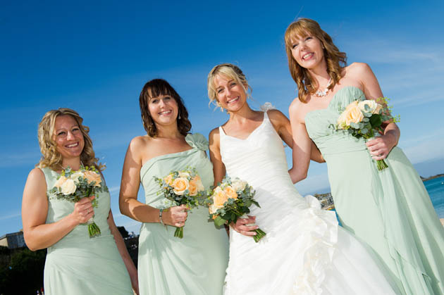 bridesmaids holding their wedding flowers photographed by Shah Photography