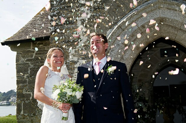 Confetti wedding photograph bride and groom outside church