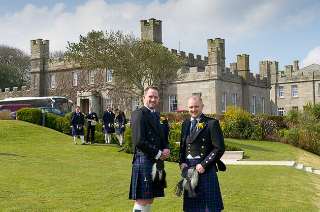 groom and bestman photographed infront of Tregenna Castle by Cornwall photographers Shah Photography