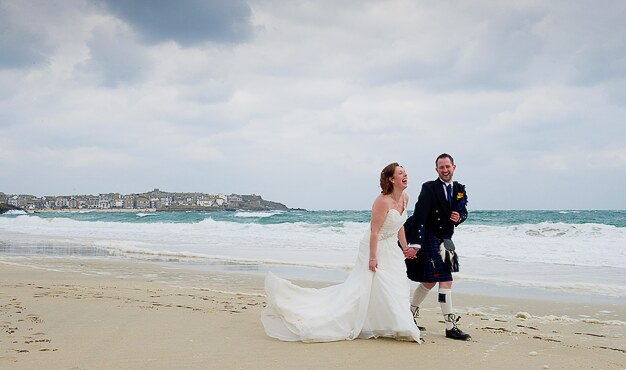 a favourite photograph from a wedding at St Ives taken on Porthminster beach in Cornwall by Cornwall photographer Pervaiz Shah