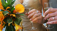 photograph of wedding rings and wedding flowers