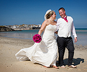 Lucy and Ross photographed after their wedding ceremony on Porthminster beach, St Ives