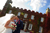 Wedding photograph of Luoise and Chris infront of Tregenna Castle Hotel, St Ives