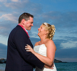 Louise and Chris photographed on Porthminster, beach St Ives after their wedding breakfast