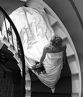 bride walking down stairs showing off her wedding dress