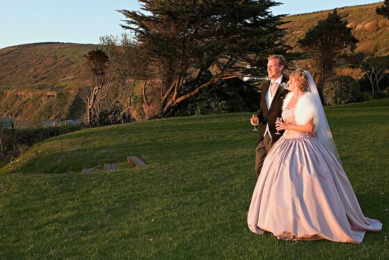 bride and groom in the grounds of Polhawn Fort with the setting sun providing fabulous light