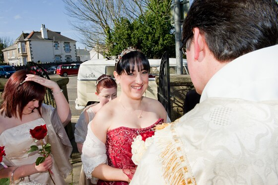 Radiant smile from the bride as she gets ready for her grand entrance to the church in Camborne