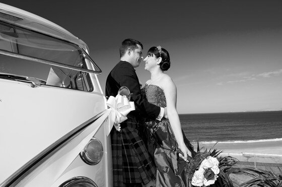 Strawberry Leisure's VW Lola the beach and the bride and groom work to create this punchy photo in black and white