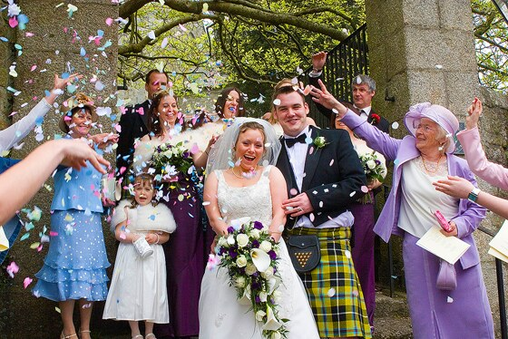 wedding photography Helston shows bride and groom being showered with confetti