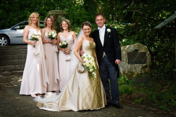 The bride and father of the bride arrive with the bridesmaids at Lanteglos Church