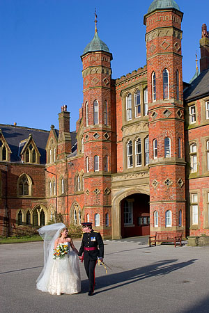 Bride and Groom photographed in the grounds after their wedding ceremony