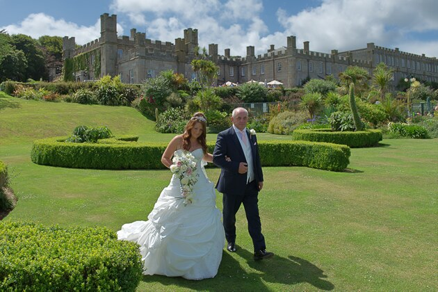 bride escorted by her father wedding photographer st ives cornwall
