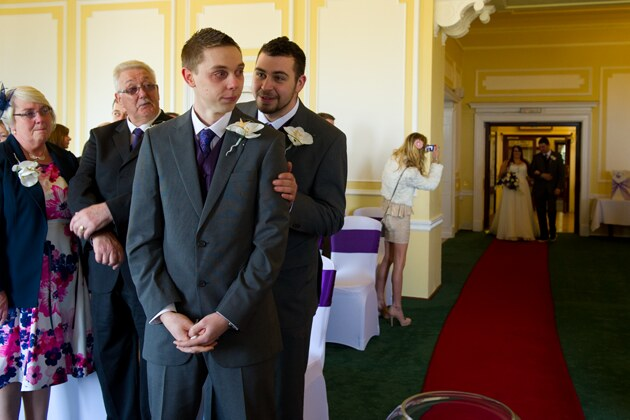 emotional groom as the bride makes her entrance