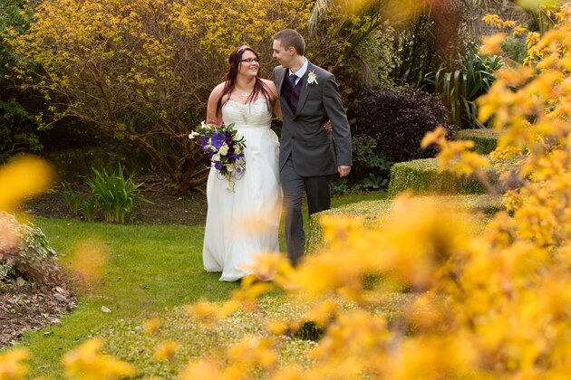 natural photograph as bride walks in the grounds of Tregenna Castle with her groom