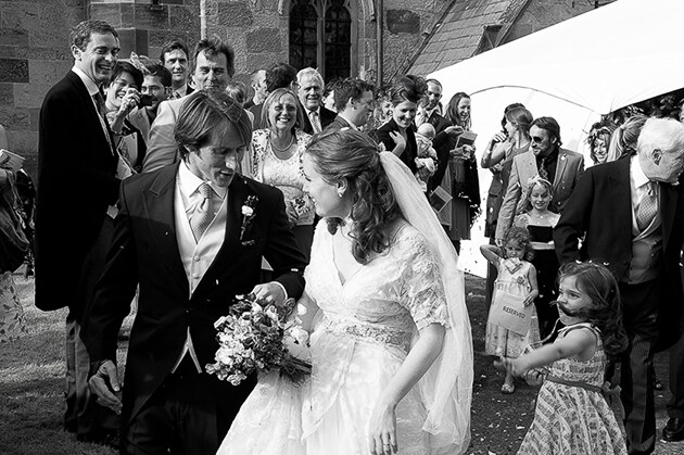 the newly weds leave the church