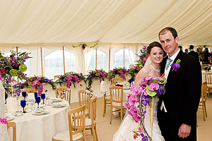 Anna and Ollie photographed in the marquee at their wedding reception