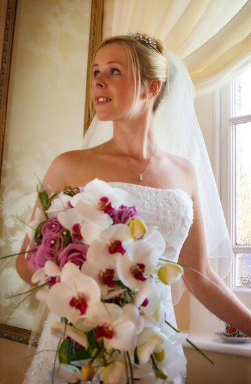 Bride with her bouquet designed by wedding flowers in Cornwall. Photo: Shah Photography