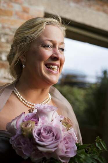 Bride Natalie with her wedding flowers by Anna photo Shah Photography