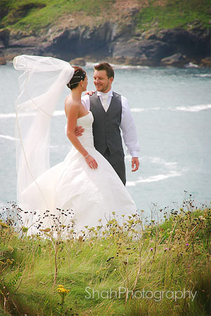 Cornish sea view with bride and groom at Mullion