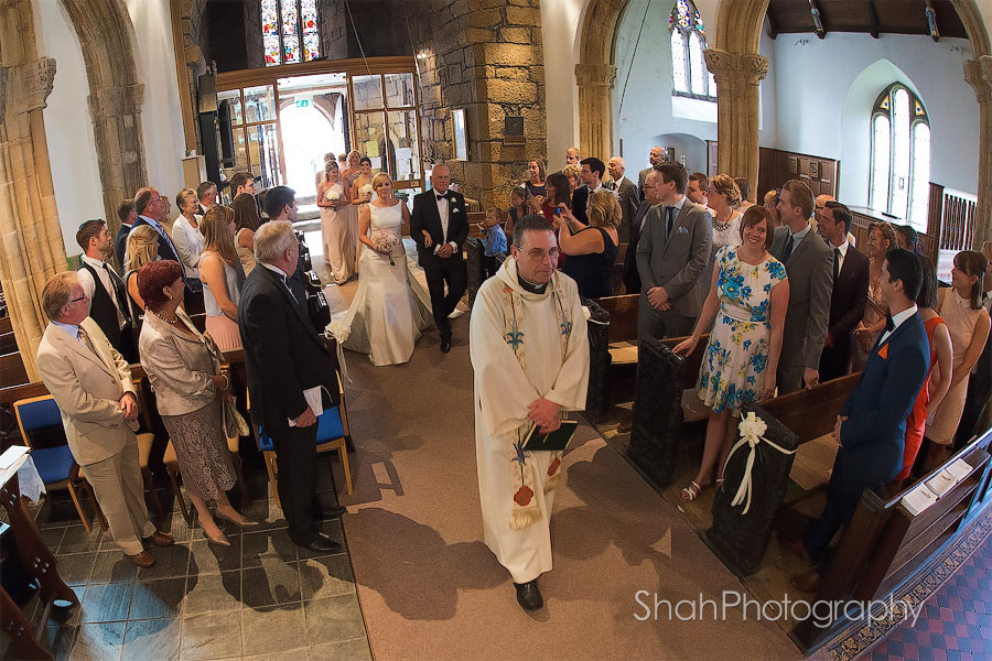 The bride walks down the aisle at St Ives Parish Church