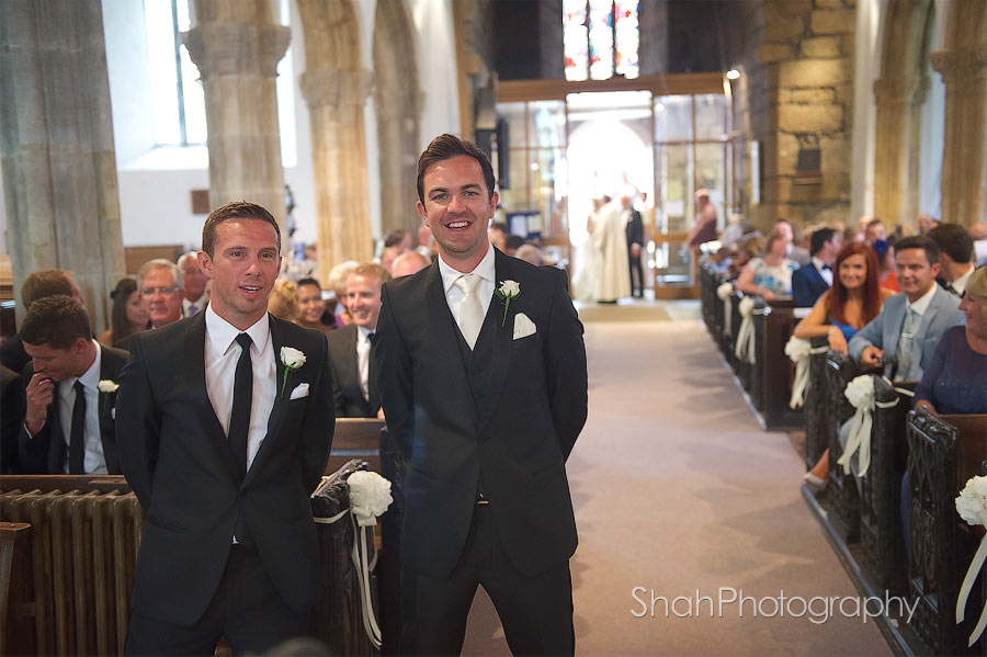 groom and best man wait for the bride to walk down the aisle